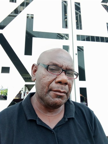 Gibson, 50, Port Moresby